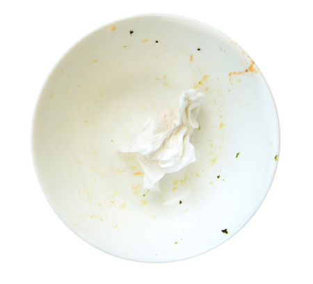 leavings: leavings on a white dish, isolate on white.