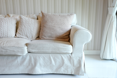 living room sofa: Living room with white sofa and curtain Stock Photo