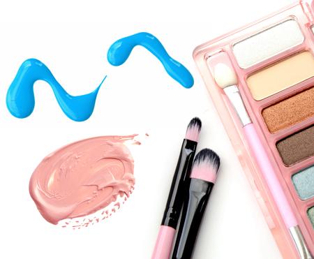 shadow box: cosmetics: nail polish, foundation, eye shadow box isolated objects Stock Photo