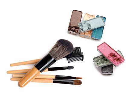Set of eyeshadows and brushes isolated on white background Stock Photo