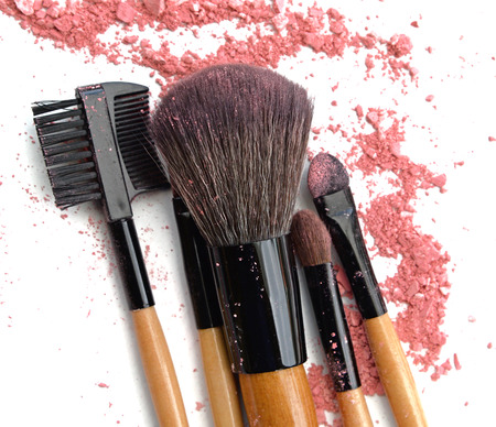 strewed: makeup brushes and broken color eye shadows