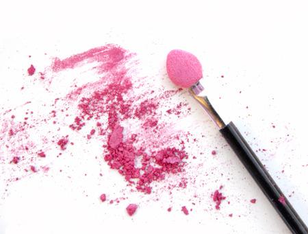 Professional make-up brush on pink crushed eyeshadow Stock Photo