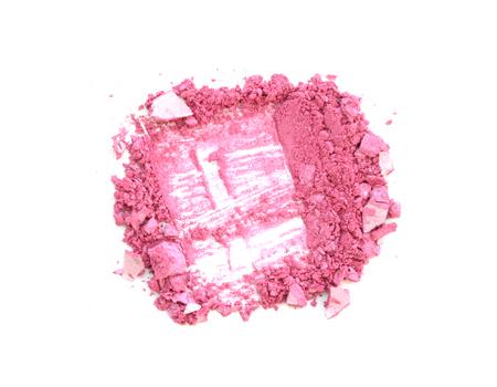 Crushed pink eyeshadows isolated on white