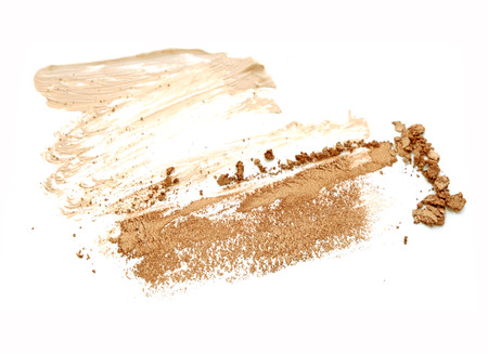strewed: beige scattered eyeshadows isolated on white background