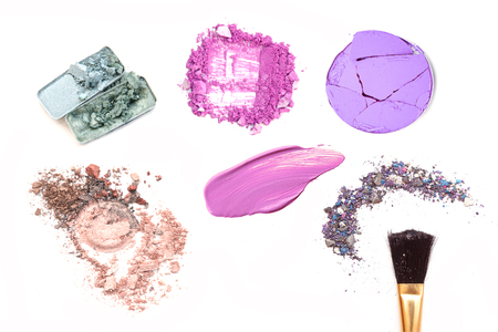 collection of various make up accessories on white background