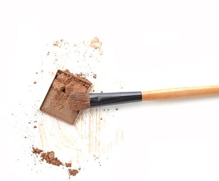 eyemakeup: Make up brown eye shadow on white with brush.