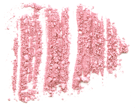 dispersed: Pink Crushed Cosmetic Power on white. Stock Photo