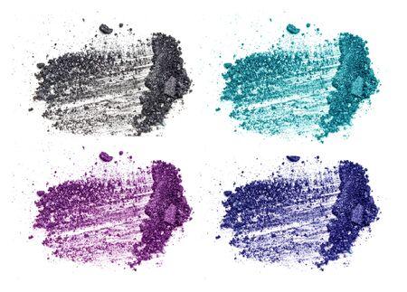 strewed: crushed eyeshadow makeup set isolated on white background Stock Photo
