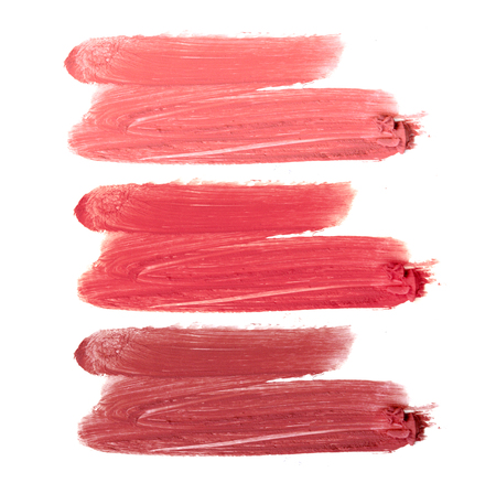 Collection of smudged lipsticks isolated on white
