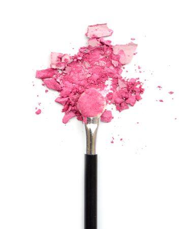 pink powder: make-up brush with pink powder explosion Stock Photo