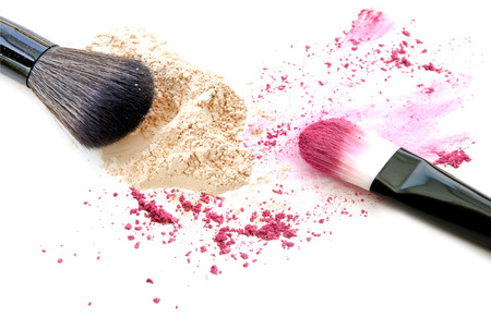 Make up powder and color eyeshadow crushed on white background Stock Photo