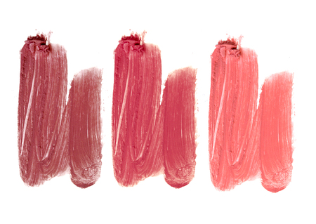 crushing: Collection of smudged lipsticks isolated on white