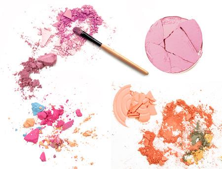 Crushed eyeshadow with brush set isolated on white Stock Photo