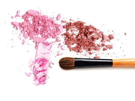 crushed eyeshadow and blush isolated on white background Stock Photo