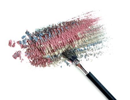 Mixed colors crushed eyeshadow and blush isolated on white Stock Photo
