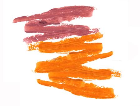 Orange and purple lipstick smeared isolate on white. Stock Photo