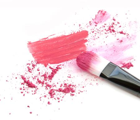 Make up blush crushed powder and lipstick smeared.