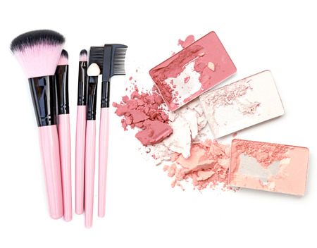 Make up powder in box. Blush make up tool.
