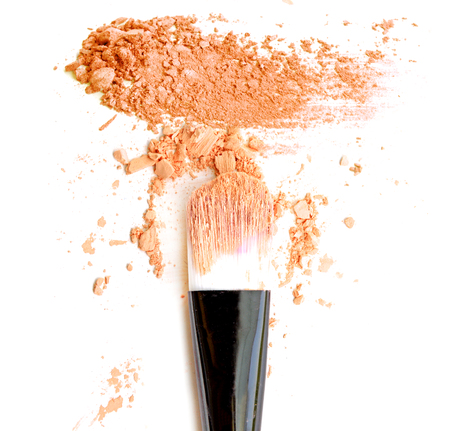Orange make up color with brush, crushed make up color.