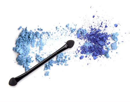 Crushed makeup on white background. Blue eye shadows.