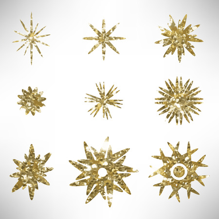 Set of golden glitter stars. Hand Drawn gold set of grungy design elements, stars. Golden grunge design elements isolated on white. Vector illustration. Ilustrace