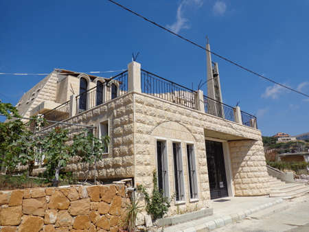SIDE VIEW OF A MARONITE CHURCH MADE OF STONES IN SOUTH LEBANON IN A SMALL VILLAGE Stock Photo - 22614566