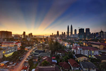 Kuala Lumpur skyline at sunrise with beautiful sky lights
