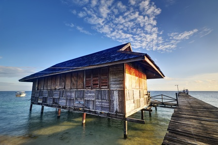Shed and Bridge on the sea with blue sky photo