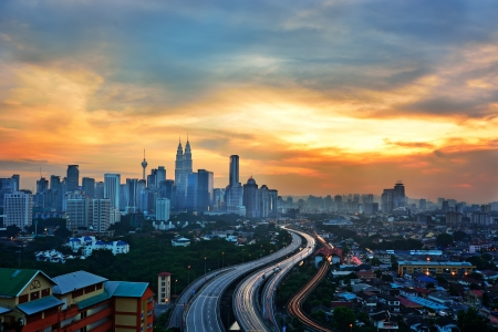 light trail: Stunning light trail scenery at the busy highway in Kuala Lumpur city during sunset