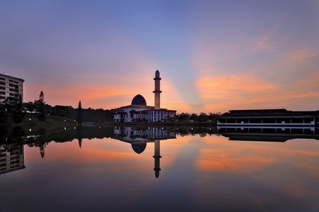 Beautiful sunrise with ray of light and mosque