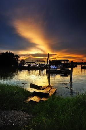 Malay fisherman jetty with beautiful sunset photo