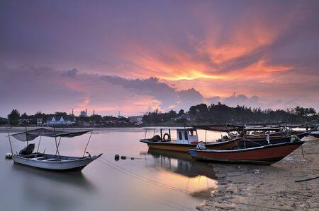 fisherman Boats with beautiful sunset  photo