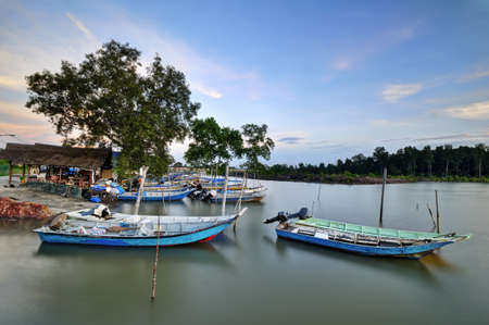 Fisherman Jetty with parking boats photo