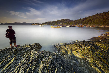 malai: Traveller at Langkawi beach Tanjung Malai with beautiful sky Stock Photo