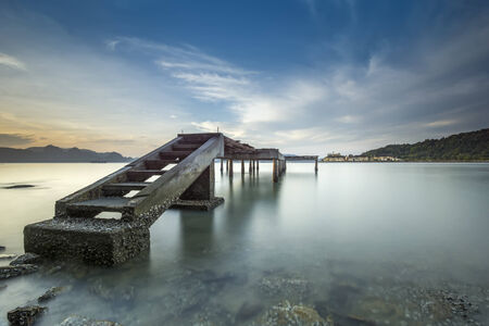 malai: Langkawi beach scene at Tanjung Malai with blue sky and bridge Stock Photo