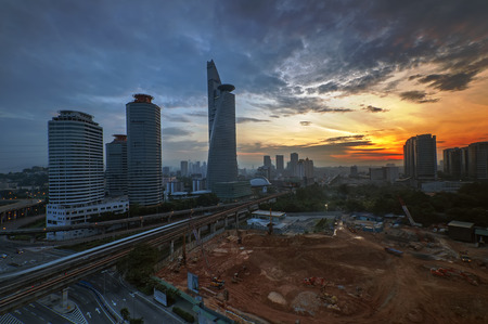 contruction: Sunrise with new contruction and bamboo tower