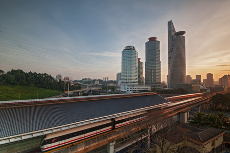 Sunrise scene at monorel station and high building tower