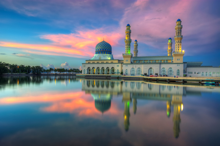 islamic wonderful: Holy Mosque in Borneo view during calm sunset with reflection at a lake Stock Photo