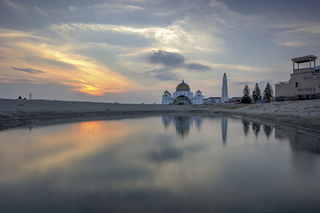 islamic wonderful: Holy Mosque in Malacca view during calm sunset with reflection at a lake