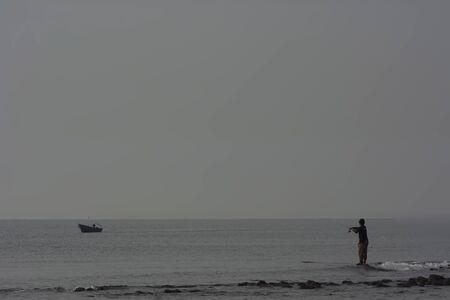 bw: BW : Fisherman at the beach