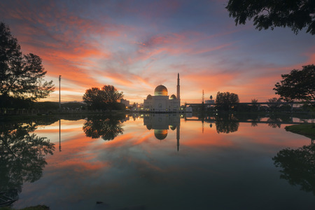 islamic wonderful: Holy Mosque view during beautiful sunrise with reflection at a lake