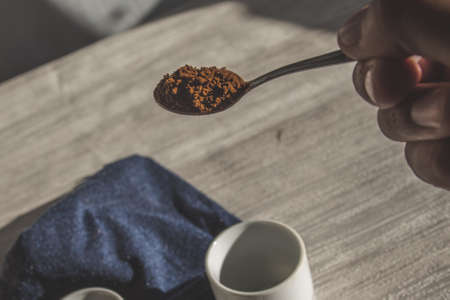 Instant coffee granules scattered brown close up. 免版税图像