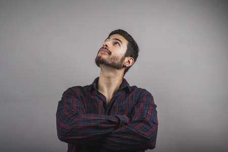 Young man waiting very dignified, beautiful young man with crossed arms Stock Photo