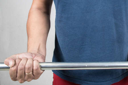 man exercising with barbell, iron bar for exercising Stock Photo
