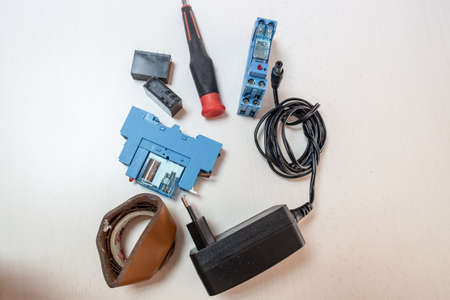 electronic components, relays, screwdriver, tape