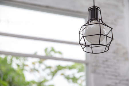 A modern style light bulb lamp on interior background. Stock Photo