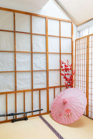 Japanese backdrop with traditional sliding door and tatami floor.