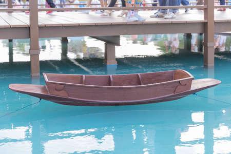 ancient Thai wooden boat on blue lake. Banco de Imagens