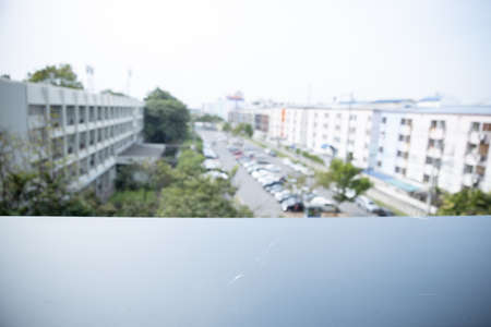 blurred of car in parking area with empty black balcony for display or design product.