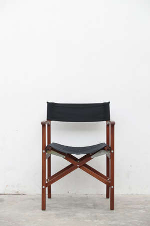 single folding wooden director seat on white cement wall background. 写真素材